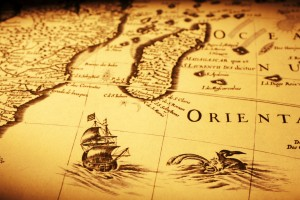 Detail from an old map showing a ship off Madagascar, a sea monster and the coast of Africa. Map is from 1600 and is out of copyright.