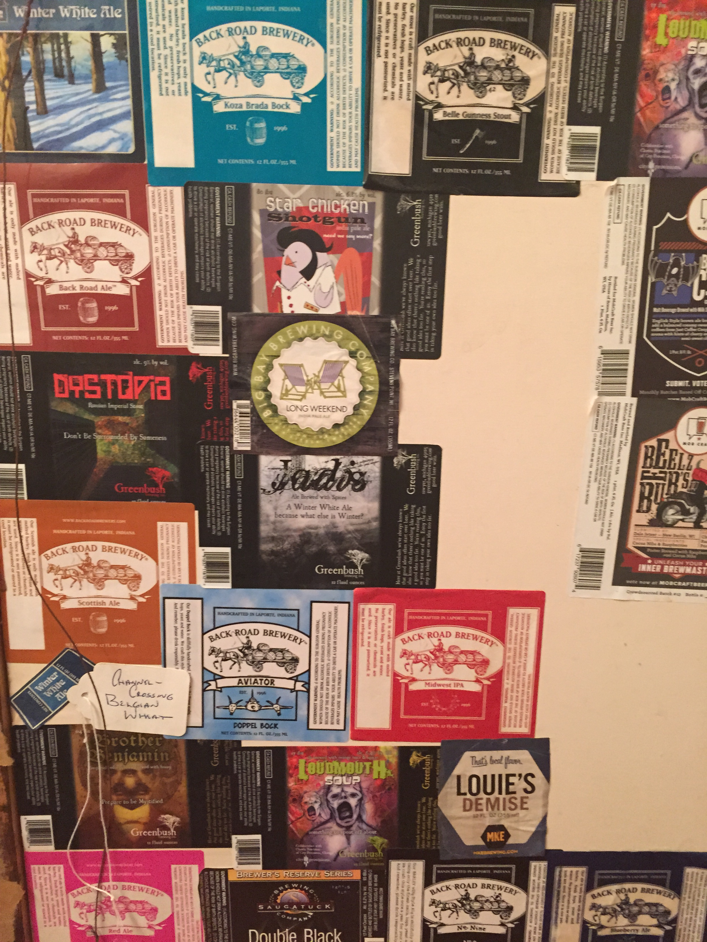 """Also a map of memory is this in progress collection of beer labels. I love craft beer and before moving my friend and I went on """"beer-cation."""" Visiting breweries around Lake Michigan from Milwaukee to Kalamazoo. These labels are a collection of where we have been."""